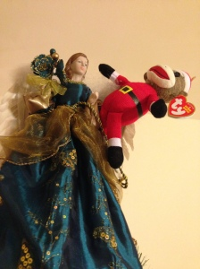 Sock Monkey Santa decides to dance with an angel.