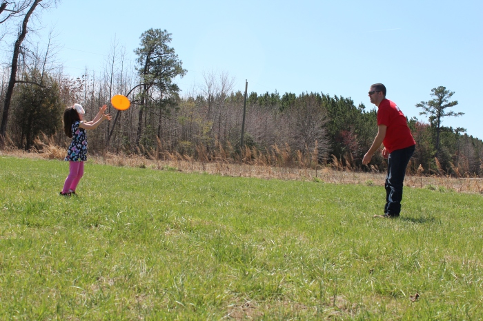 Chris took a lot of time teaching E how to throw a Frisbee. She got very good. The bunny ears didn't hurt either.