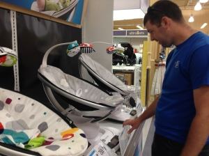 Chris was totaled mesmerized by the mamaRoo and all of it's features. It can simulate the feel of a car ride and the motion of a kangaroo among other things. We may have to buy him one instead of the baby. Haha.